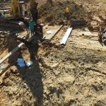 The clay is so sticky and wet that the excavator must use wooden timber mats to avoid sliding and sinking.