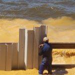 Installing the vinyl seawall at Toledo Bend