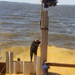 Installing the vinyl seawall at Toledo Bend