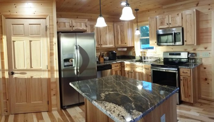 The kitchen is nicely equipped with dishes,pots/pans/coffee maker/dishwasher/etc — at Toledo Bend Cabins.
