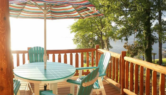The brightly colored deck furniture is made from recycled milk jugs! — at Toledo Bend Cabins.