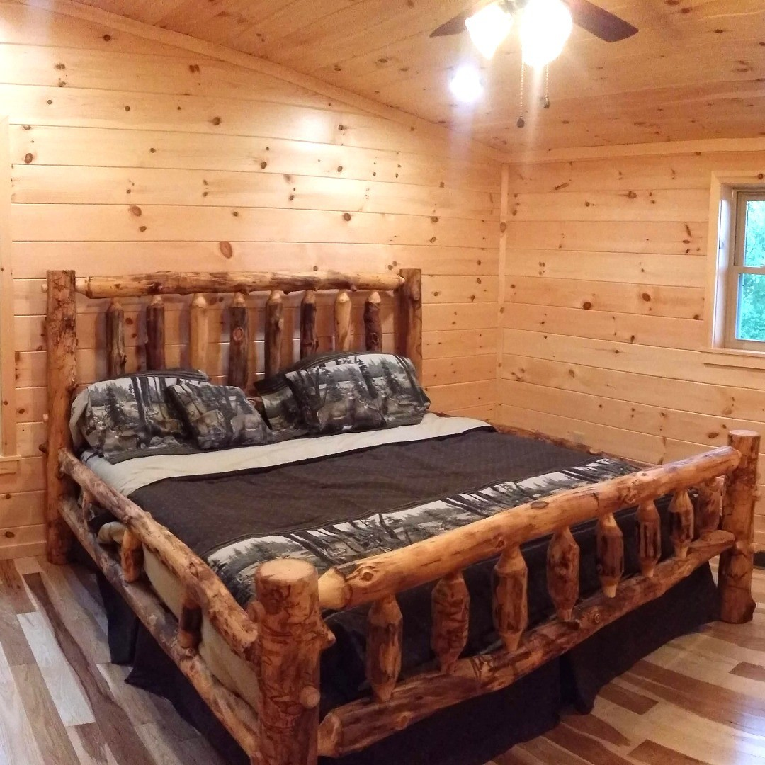 The master bedroom at the Toledo Bend Cabin has a king-sized apsen lodgepole bed.  In fact, all three of the bedrooms have kings sized aspen lodgepole beds!  #ToledoBendCabins #ToledoBend #ToledoBendCabin