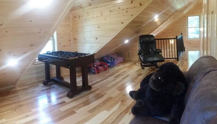 The loft area has a massaging recliner and a foosball table!