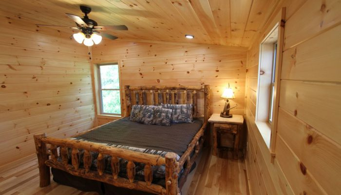 Bedroom 1 has a King Size lodgepole bed.