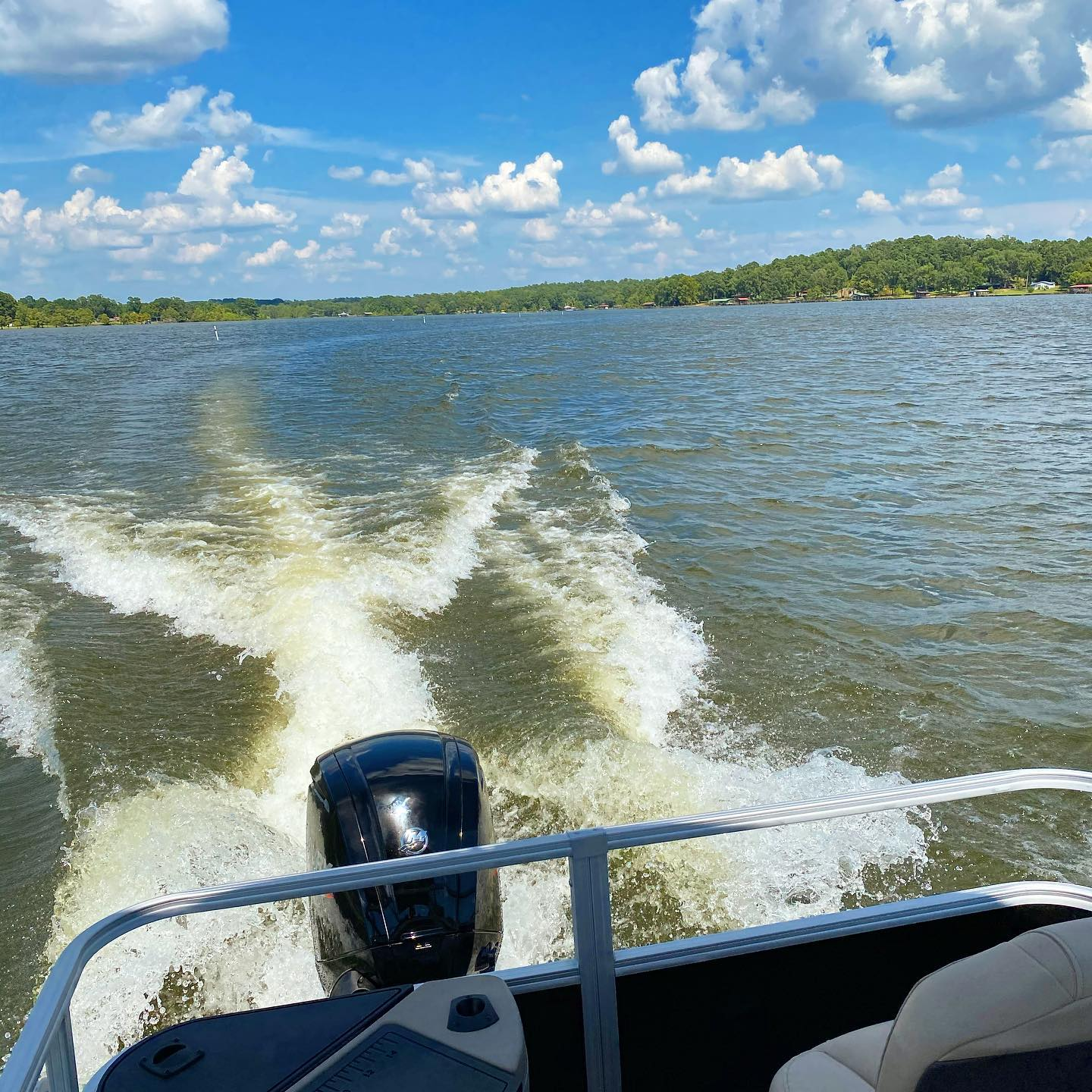 On the pontoon-Making waves and catching rays. The lake is open and ready! #pontoonboat #catchingwaves #ridingboats #lakefun
