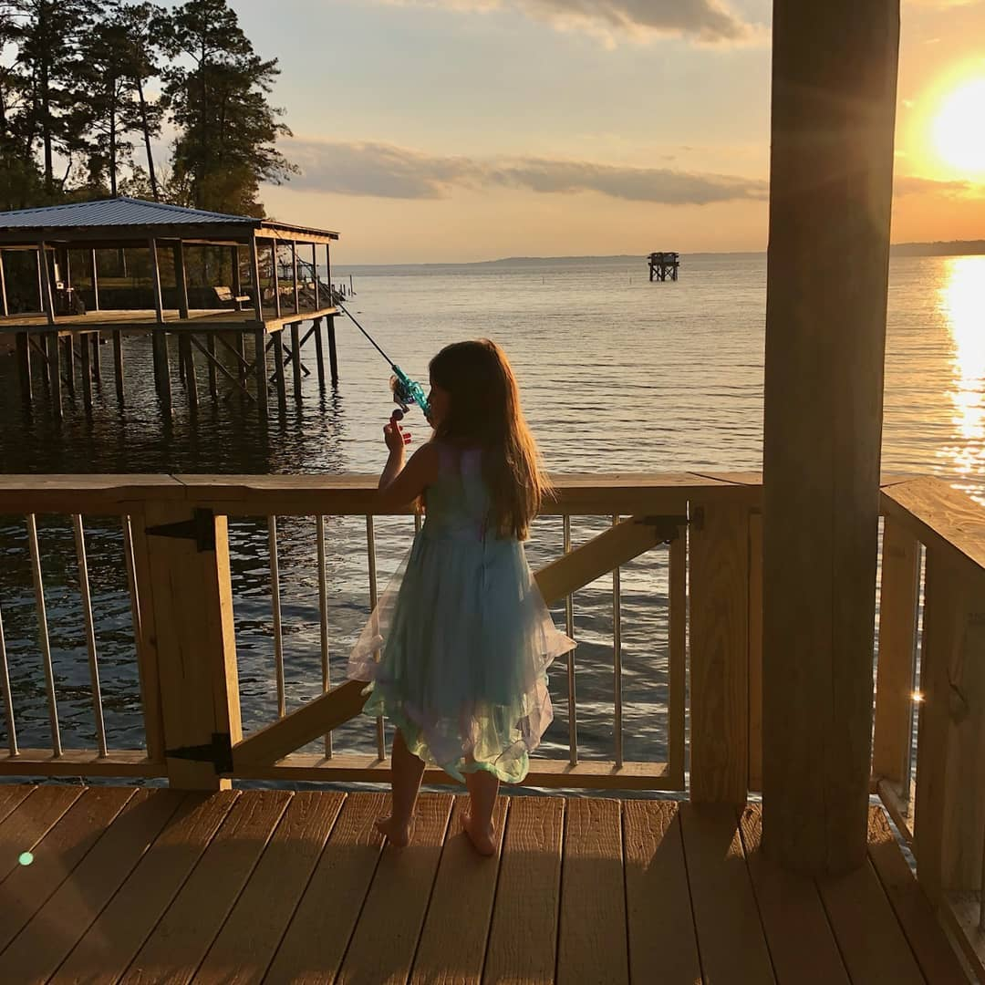 Our guest from this weekend sent a picture of her little girl fishing from our boathouse at sunset this weekend.  With her permission I would like to share it with you.   #sunset #toledobendcabin #toledobendcabins #toledobendlake #toledobend #fishing