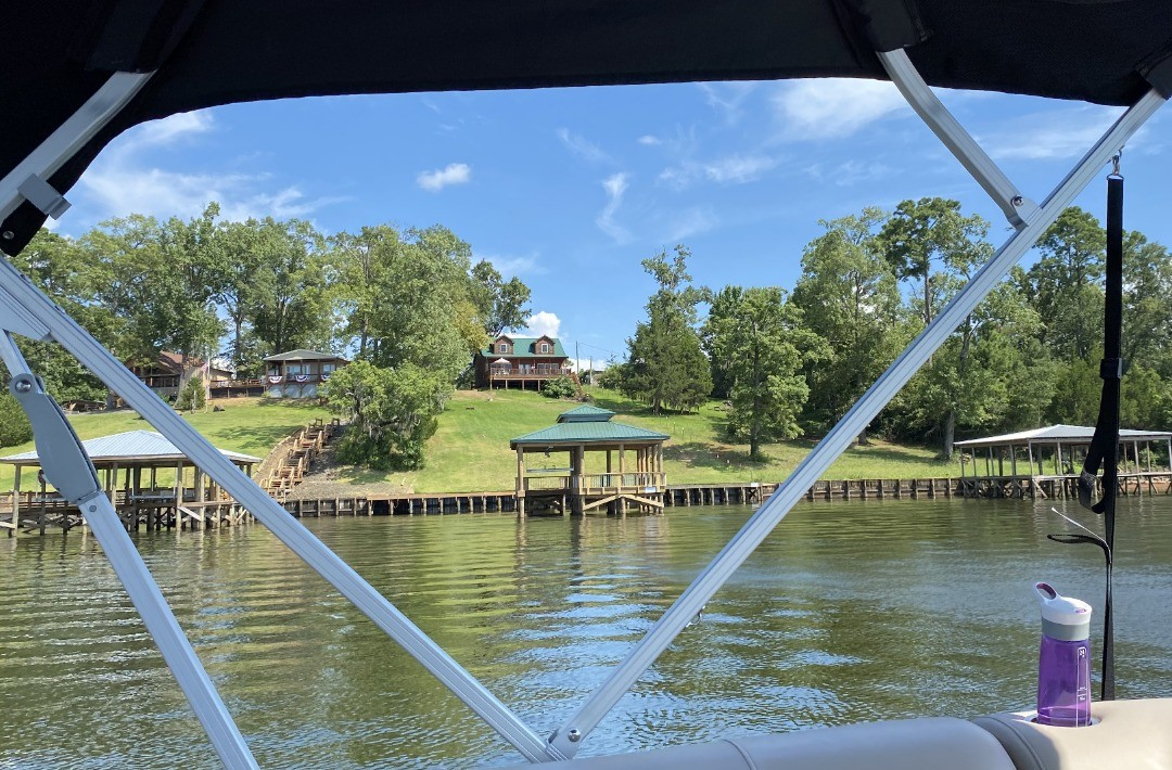 The pontoon just launched from the boathouse at the Toledo Bend Cabin.  Just one of the magnificent views to be found at the cabin.  ToledoBendCabins.com  #toledobend #toledobendcabin #toledobendcabins #pontoon #pontoonboat